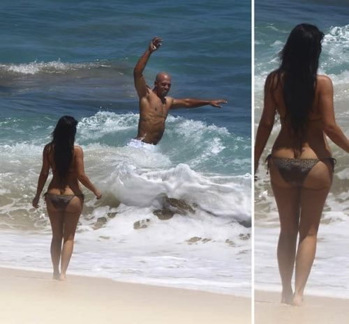 Meanwhile, here's a picture of Kim and HER FAT ASS . . . frolicking with ...